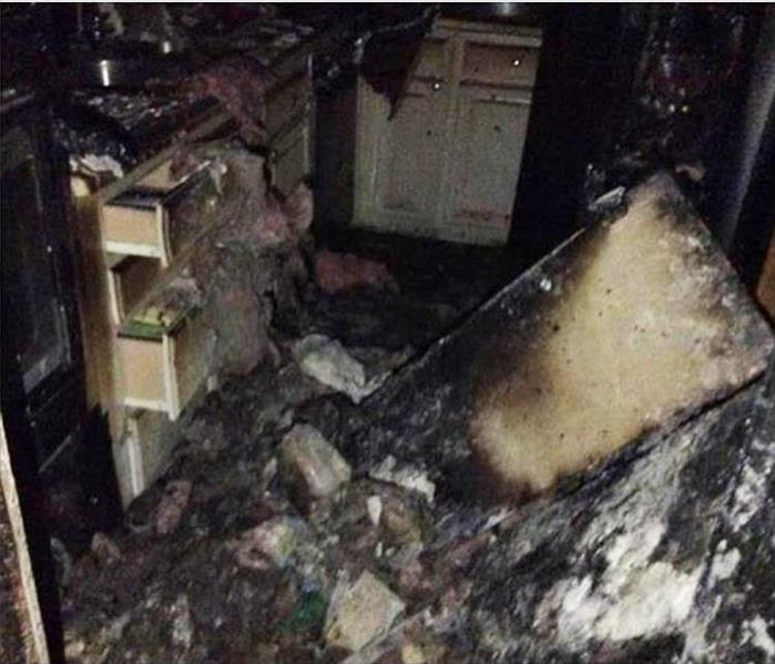 burnt cabinets, appliances in a kitchen fire