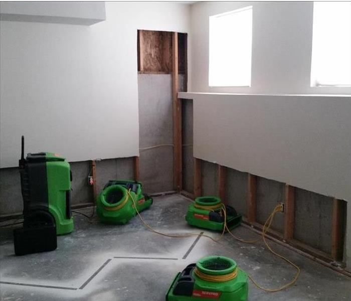 pad, drying equipment, cut drywall and studs