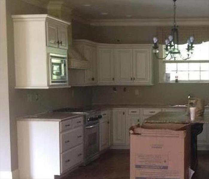 restore and repaired ceiling, new kitchen cabinets and appliances